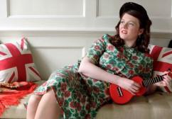 Katy on the sofa with red ukulele