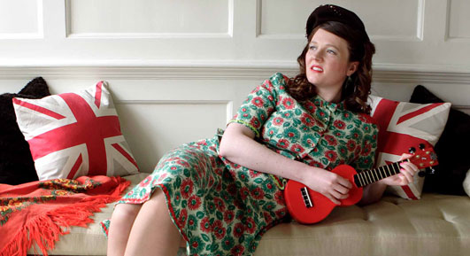 Katy on the sofa with red ukulele